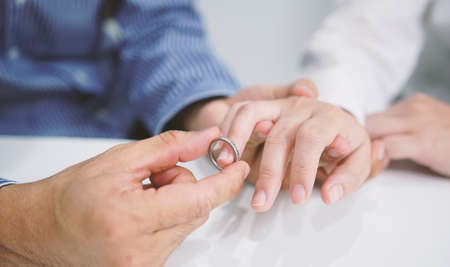 Groom gently wears the wedding ring. Valentine day, Wedding day