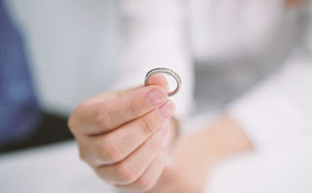 Hand holding a ring Фото со стока
