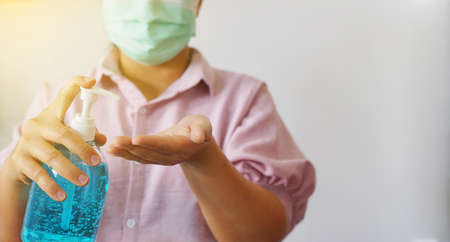 Female hand using alcohol gel disinfecting hands. prevent against infection of Covid-19 outbreak