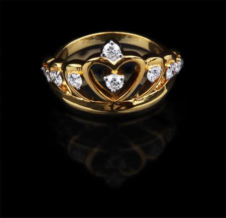 Golden diamond ring on black background photo
