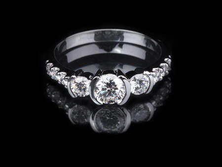 engagement ring: White gold diamond ring on black background