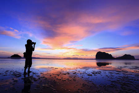 The Photographer Photographer takes a good shot on the PangMeng beach,Trang, Thailand photo