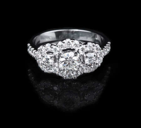 White gold diamond ring on black background photo