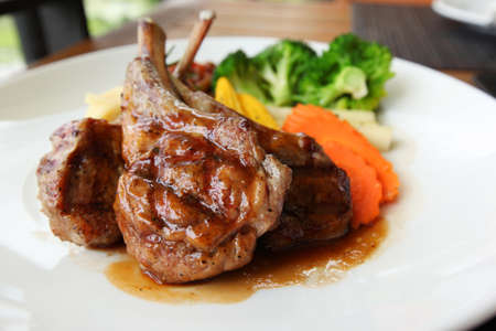 Roasted lamb with tomato sauce and fresh vegetables photo