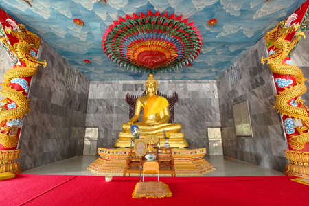 veneration: Buddha Statue Golden in Buddhist Temple with monk seat and red carpet Editorial