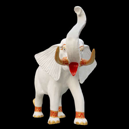 White elephant statue isolated on black photo