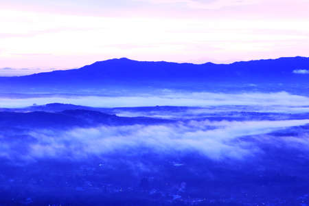 Landscape  Mountains, ascending or a sitting down sun with beautiful fog Stock Photo