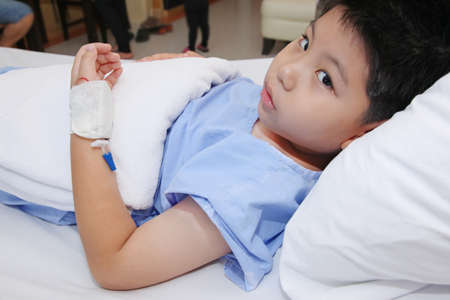 lint: Young boy wear patient suit  in hospital bed Stock Photo