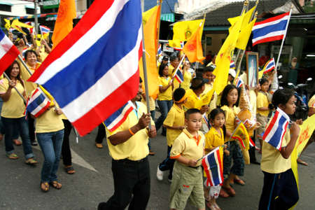 nationalist: SONGKHLA - DEC 5  Royalists celebrate the 80th birthday of Thai King Bhumibol Adulyadej while attending celebrations on street on Dec 5, 2007 in Southern Songkhla, Thailand   Editorial