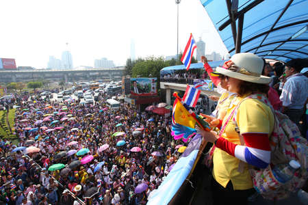 amnesty: BANGKOK - DECEMBER 9 : Protesters hold an anti-government rally on December 9, 2013 at Victory Monument . They blow whistles to make symbolic protest against the amnesty bill and want government resign and replaced with peoples council.
