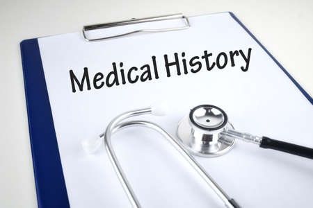 Selective focus image of stethoscope with Medical Fraud wording on a wooden background. Medical concept