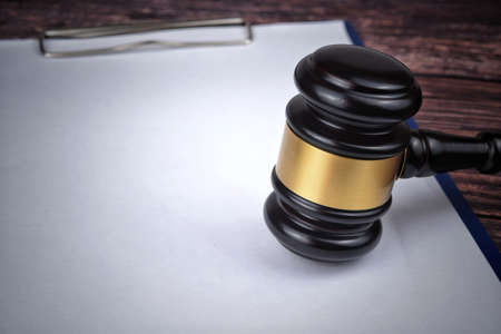 Selective focus image of gavel isolated over a wooden background. Law concept Stock Photo