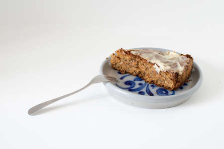 sliced carrot cake, served on a ceramic plate with decor