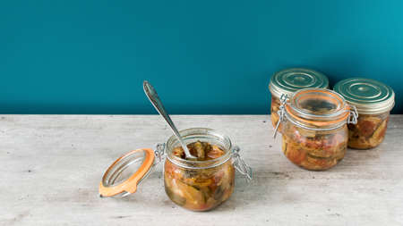 jam jar of ratatouille with vegetables in the kitchen interior, preserve vegetables 스톡 콘텐츠