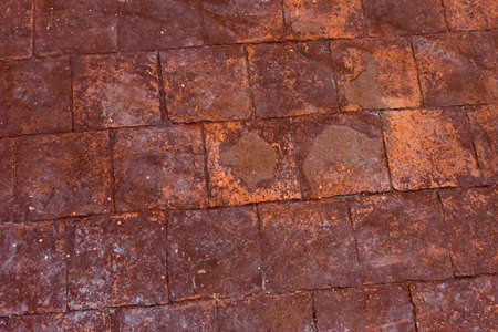 brick orange floor inside an old historic house, close-up view