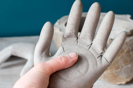 production of art objects in a creative art workshop, concrete bowl and concrete hands, art workshop
