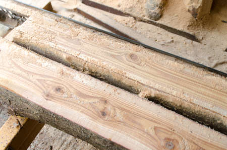 Wood timber construction material Stock in warehouse. Work with wood