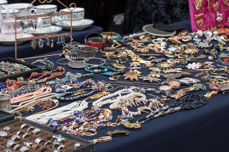 Old flea markets. Antique show, France, Paris, antique jewelry on display at the market