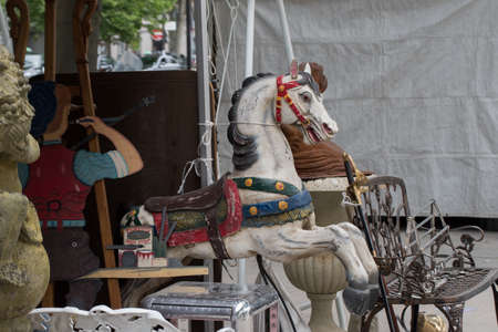 Old flea markets. Antique show, old wood horse