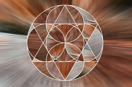 Abstract spiral symmetrical pattern. Circle ornament and orange ray. background shaft of light in the middle of the image