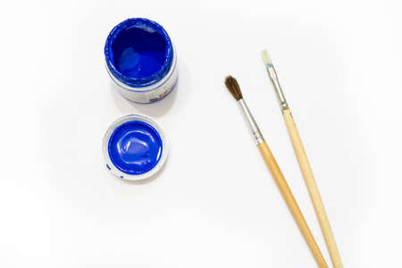 blue paint: Blue paint with brushes Stock Photo