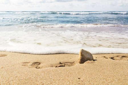 footsteps on a sand beach Stock Photo