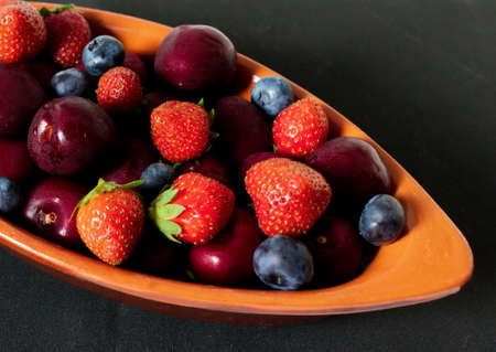 Blueberry, Strawberry and cherry faience bowl with fruit