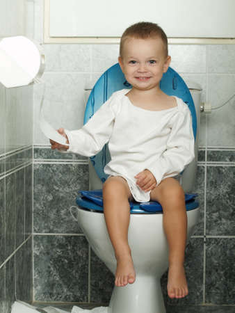 loo: little baby sitting on the toiltet Stock Photo
