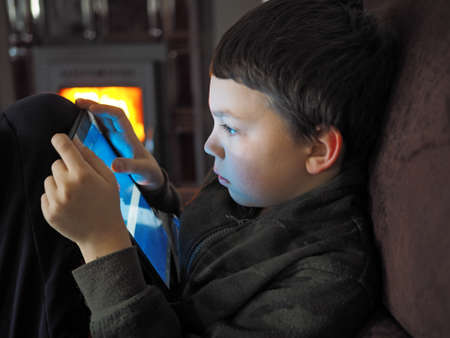 indoor shot young boy with mobile