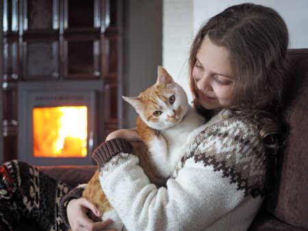 indoor shot young girl with cat Stock fotó
