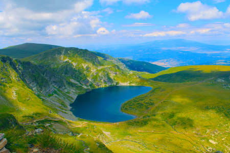 Panoramic picture of a high mountain lake in a sunny day Stock Photo