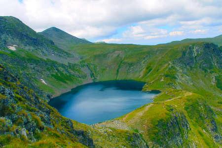 A lake in the Rila mountain in Bulgaria bird eye view in a sunny day in the spring
