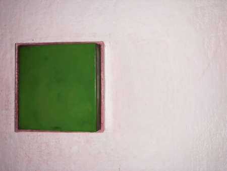 green close up shot of a electricity swich on the wall
