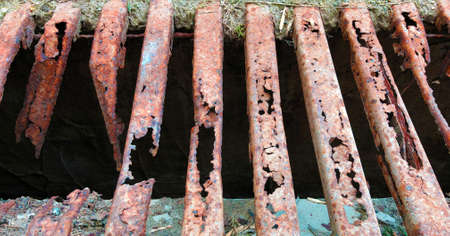 old and rusty decayed metal street shaft grid close up
