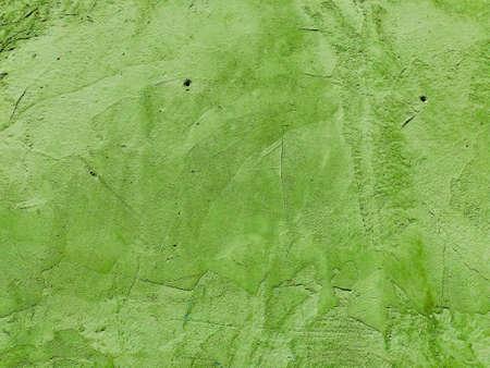 fresh light green grungy bumpy wall facade outside of a house Stock Photo