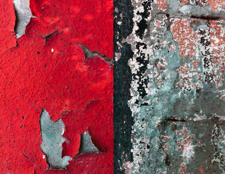 old vintage wall with cracked red and black paint showing stones behind vibrant color background