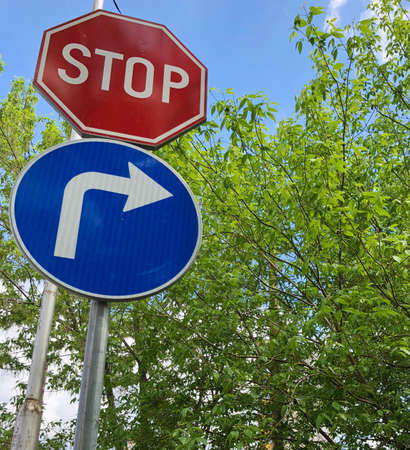 Stop and move right signs in a bright sunny day