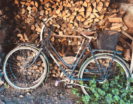 old rusty bikes being unused for a long time on firewood background vintage old rural concept