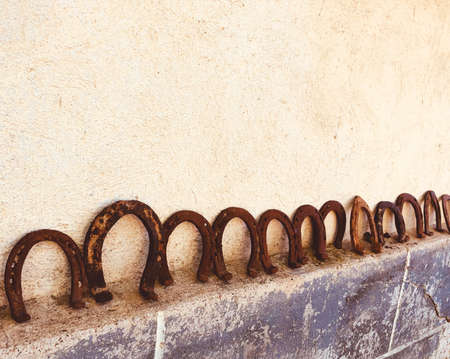 rusty horseshoes on a wall collected good luck concept