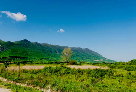 mountain landscape on a bright sunny day in spring time seasonal concept Stock Photo