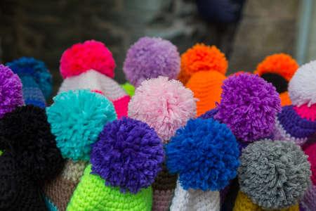 close up of colored pom pom