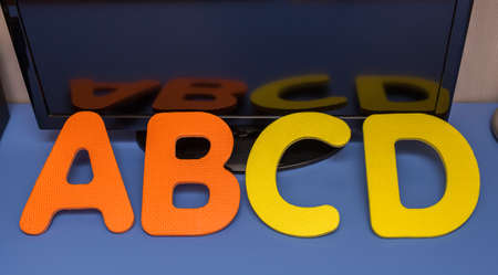 abcd on table with reflection