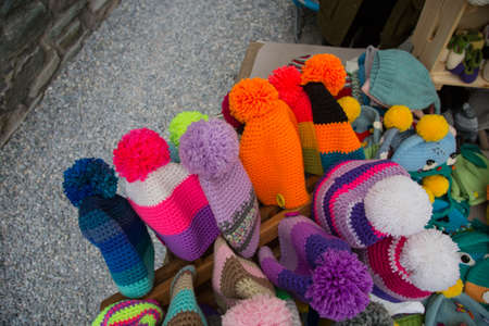 close up of pompoms and colorful hats