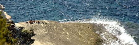 bathers on spied cliffs