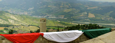 view from the fortress of San Leo with Italian tricolor