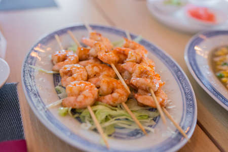 closeup of chinese food with grilled shrimps and vegetables Stock Photo