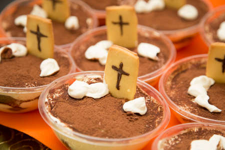 horizontal image with detail of chocolate sweets with cookies prepared for halloween party