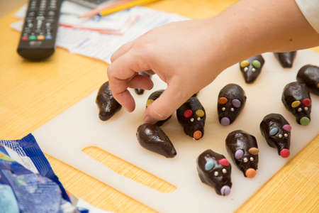 horizontal image with detail of the preparation of chocolates for a birthday party Banco de Imagens