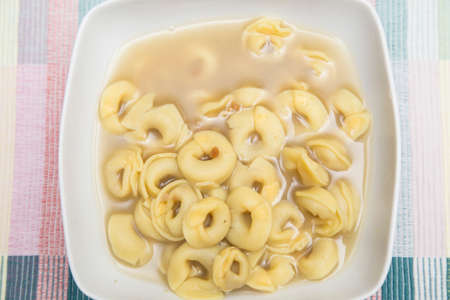 horizontal image with detail with top view of a plate of pasta in hot broth Banco de Imagens