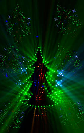 abstract vertical image of a stylized Christmas tree illuminated with LED lights of various colors